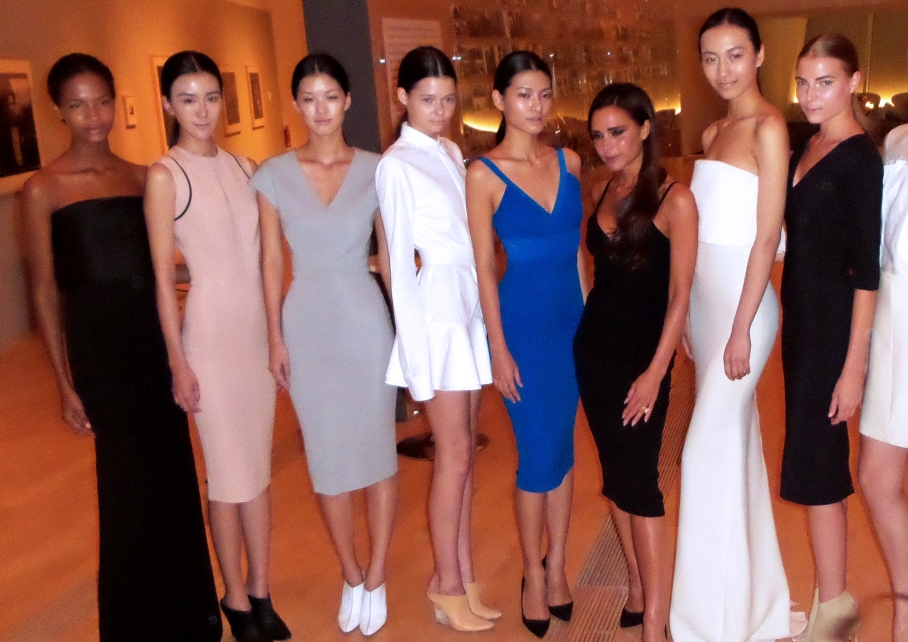 Victoria Beckham, third from fright, with models